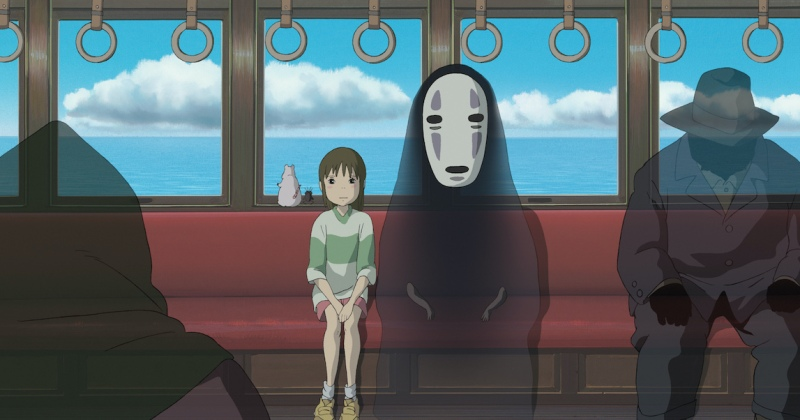 Chihiro and No Face ride on the train to go see Zeniba.