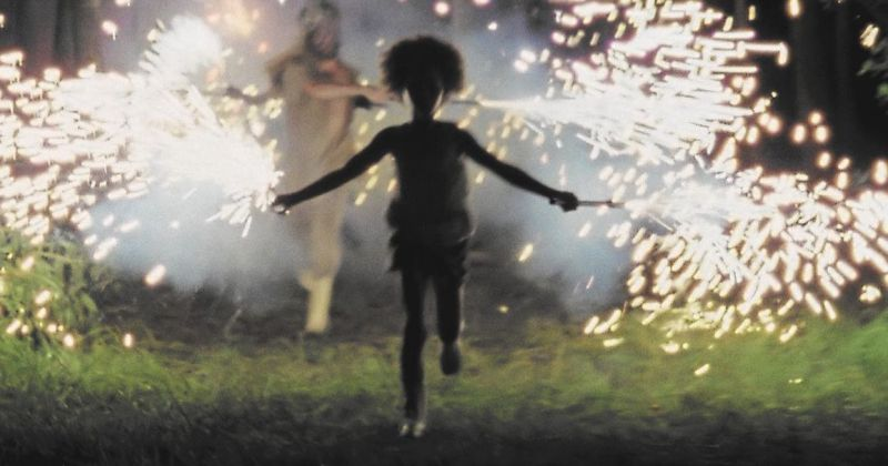 Screenshot of Hushpuppy running with sparklers from Beasts of the Southern Wild.
