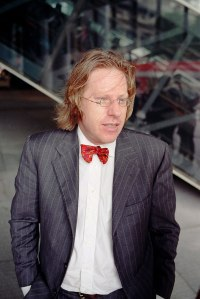 A photo of Jonathon Keats wearing a pinstripe suit with a red bowtie.